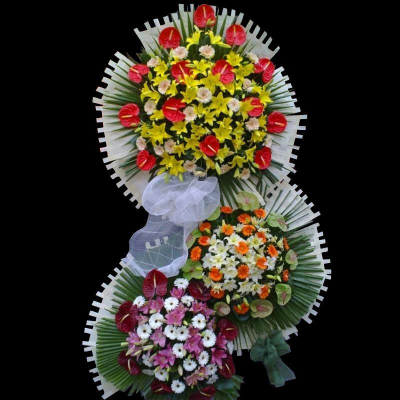 تاج گل برای عرض تبریک 3 طبقه با گلهای آنتریوم لیلیوم ژربرا
